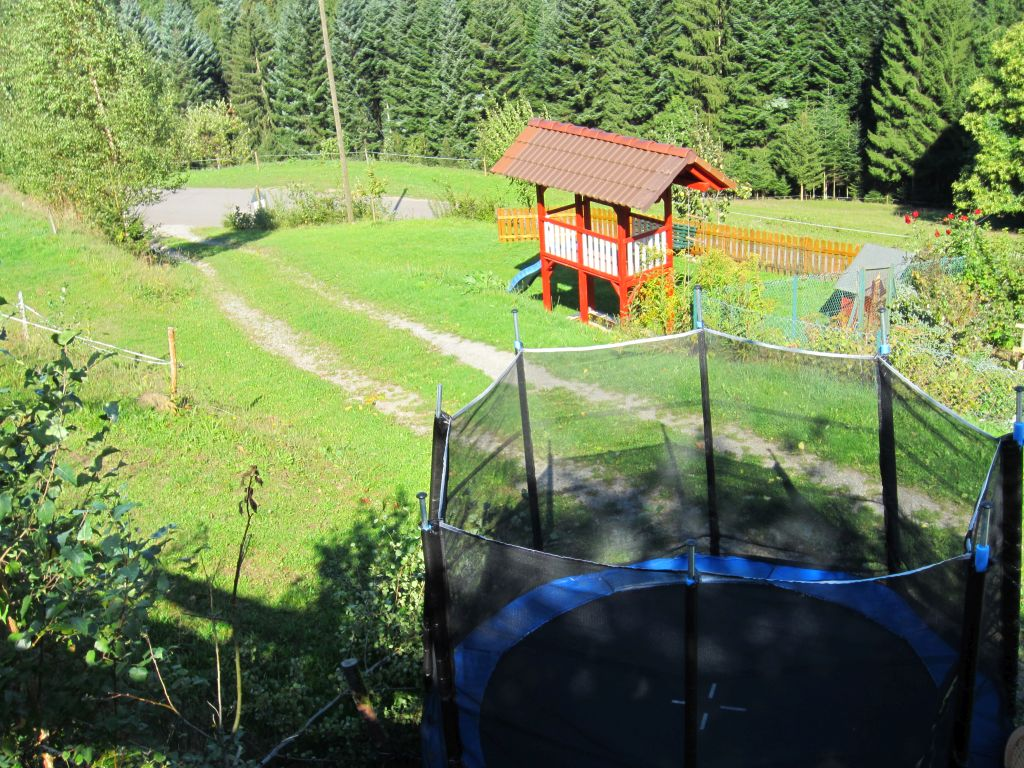 Large trampoline and playhouse